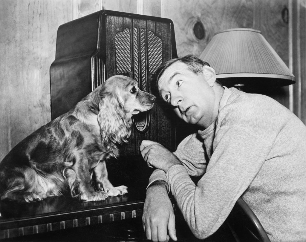 Man and dog listen to radio